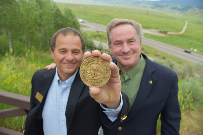Photo: National Museum of Wildlife Art Museum Director Steve Seamons and Joel Sartore stand with the Rungius Medal