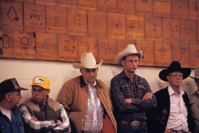Photo: A group of men waiting around at a cattle auction in Cottonwood, California.