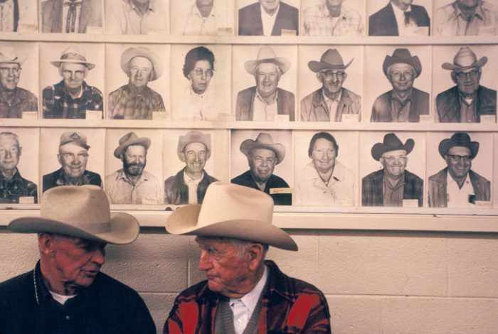 Photo: Two men talk while waiting around at a cattle auction in Cottonwood, California.