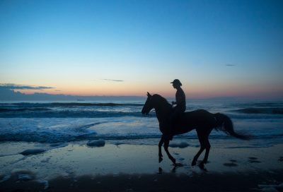 Photo: A cowboy on Virginia Beach at sunrise.