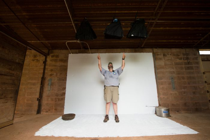 Picture of a man pointing out lights for the bison shoot at the Oklahoma City Zoo