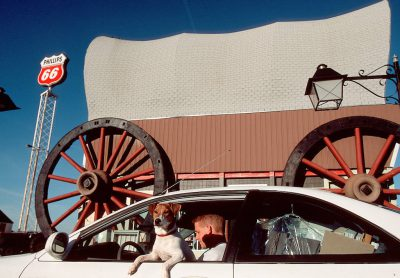 Photo: A customer and his dog make a stop at Milford, Nebraska's covered wagon gas station.