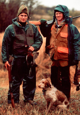 Photo: Paul Sartore and Mark Mankin with their Brittany spaniel after a pheasant hunt in Nebraska.