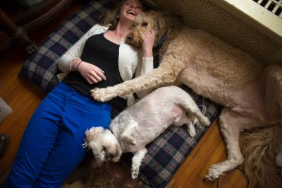 Photo: A teenage girl relaxes with her two dogs.