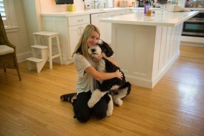 Photo: A woman hugs her dog close.
