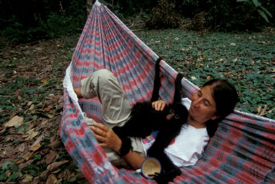 Photo: An oprhaned spider monkey with Rosamaria Ruiz in Bolivia's Madidi National Park.