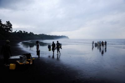 Photo: A crew arrives at the Moraka Playa on Bioko Island.