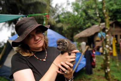 A woman holds a tree hyrax (Dendrohyrax dorsalis) on Bioko Island.