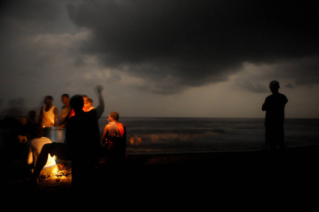 Photo: A dance/drum session is held on the beach of Bioko Island.