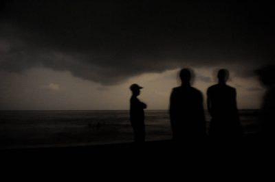Photo: Night time shots of people on the beach of Bioko Island.