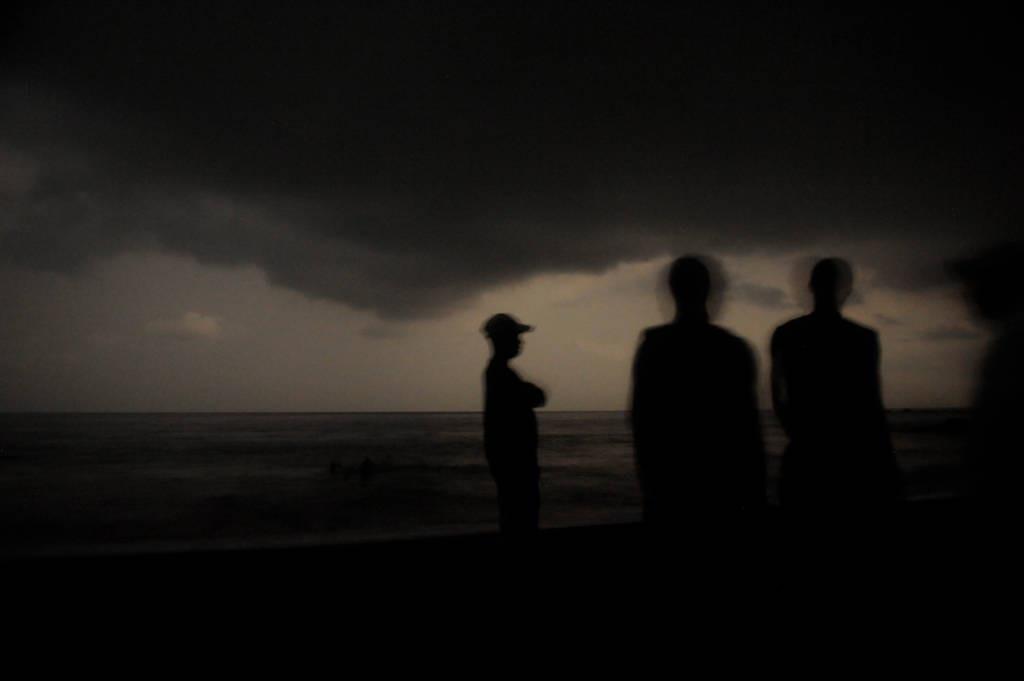 Photo: Night time shots of people on the beach of Bioko Island.
