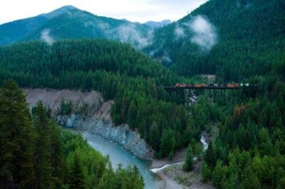 Photo: A train crosses over a bridge in the Walton area of Glacier National Park, Montana.