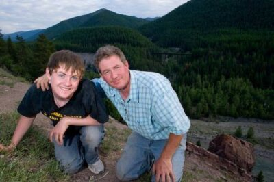 Photo: Joel Sartore and his son, Cole, stop to take a photograph together in the Walton area of Glacier National Park, Montana.