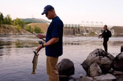 Photo: Two biologists fish the Noxon Rapids Dam, Montana.