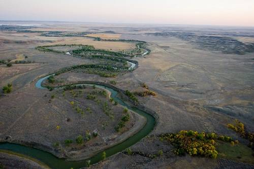 Photo: An aerial of the Bowden natural gas drilling area along the MIlk river northeast of Malta, Montana.