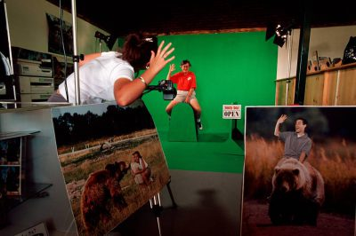 Photo: Visitors to a photo booth at Bear World, near Yellowstone National Park get their photo taken with grizzly bears -- the safe way.