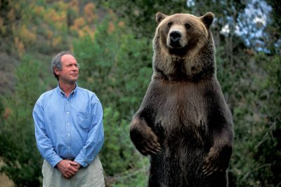 Photo: Doug Chadwick with one of the trainees at Wasach Mountain Wildlife, an animal training facility in Utah.