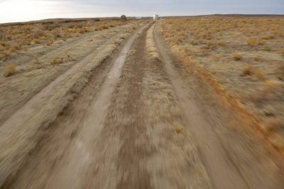 Photo: Tire tracks through a sand sage prairie pasture near Laverne, OK.