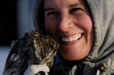Photo: An owl with its keeper at a raptor recovery center in Nebraska.