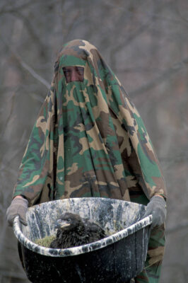 Photo: A researcher studies eagles while wearing a camouflage cover.