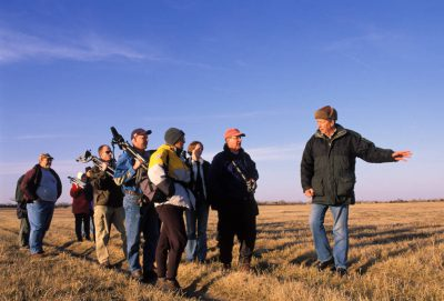 Photo: Birdwatchers carry cameras at Rowe Audubon Sanctuary in Nebraska.
