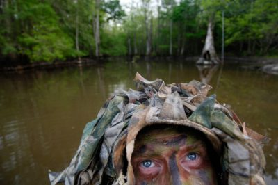 Photo: A bird watcher at Bayou De View in the Cache River National Wildlife Refuge, Arkansas.
