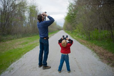 Photo: Charles DeVries bird watches with his five-year-old son, Ellery, at the start of the Steamboat Trace trail just south of Nebraska City, Nebraska.