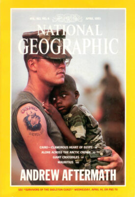 Photo: Joel Sartore's photo on the cover of the April, 1993 issue of National Geographic magazine shows a Marine holding a young boy in the aftermath of Hurricane Andrew.