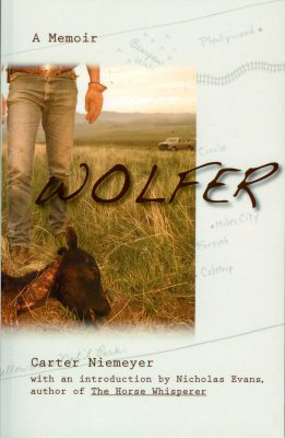 "Photo: Joel Sartore's photograph of Carter Niemeyer is featured on the cover of ""Wolfer: A Memoir."""