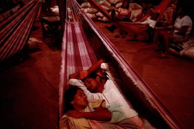Photo: Fruit and vegetable vendors sleep with their goods the night before the weekend market opens in Paragominas, Brazil.