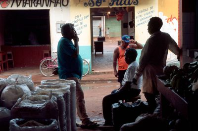 Photo: Manqueira (left) chats with fellow fruit & farinha vendors in the market in Pargominas, Brazil.