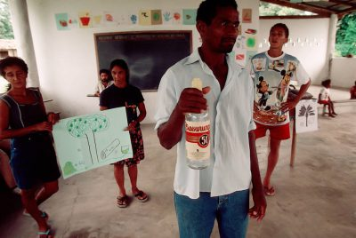 Photo: A man who once traded trees for alcohol participates in a forest fruits workshop in Quiandeua, a small village in the Brazilian Amazon.