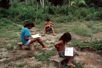 Photo: Villagers using a booklet coauthored by Patricia Shanley illustrating