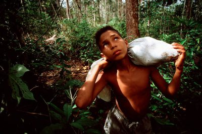 Photo: A native child carries bacuri fruit back to his village along the Capim River, a tributary of the Brazilian Amazon.