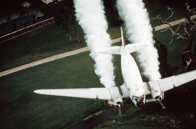 Photo: DC3 planes blanket housing developments in marsh areas with a mixture of diesel fuel and malathion to kill off mosquitoes.