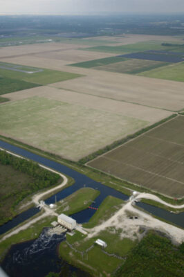Photo: Aerial of canals and agricultural development at the edge of wetlands near Miami, Florida.