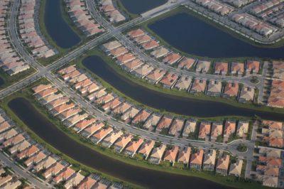 Photo: Aerial of housing developments encroaching on wetlands near Naples, Florida.