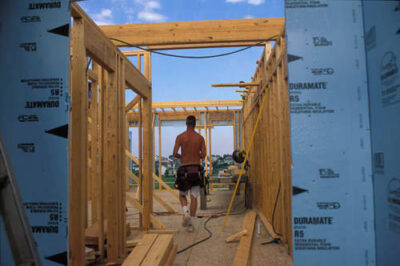 Photo: Constuction Workers work on new homes in a newly developed part of Lincoln, Nebraska.