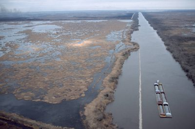 Photo: Chemical barges moving through Sabine NWR, a sensitive wetland habitat.