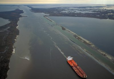 Photo: Barges filled with hazardous chemicals move through the Intercoastal Waterway in Sabine NWR every day.