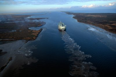 Photo: A tanker moves down a channel which bisects Sabine NWR in Louisiana.