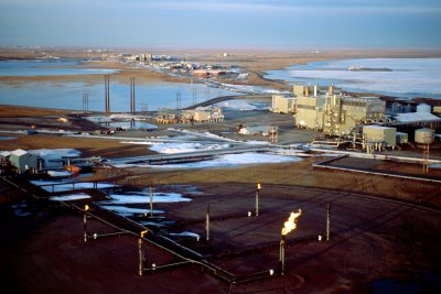 Photo: An aerial of Prudhoe Bay. In operation since the 1970's, the aging field is nearing the end of its life with no funding or plans in place to clean up the mess when the oil plays out.
