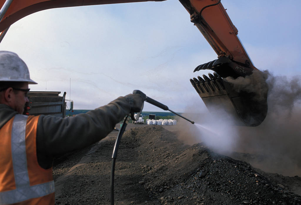 Photo: Construction workers work on an oil pipeline in Prudhoe Bay, Alaska.