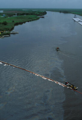 "Photo: Cleanup work on an oil spill in the Texas Intercoastal Canal, using a ""control boom""."