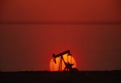 Photo: An oil pumping unit in silhouette, Worland, WY.