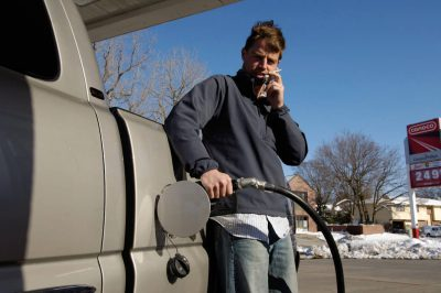Photo: A young man fills up his truck with gas in Lincoln, Nebraska.