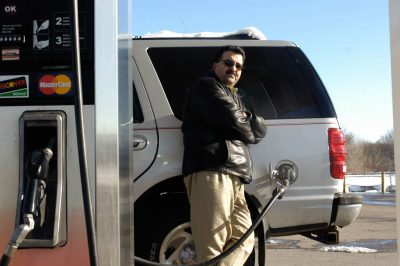 Photo: A man fills his SUV with gas in Lincoln, Nebraska.