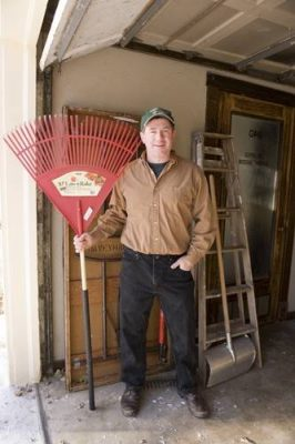 Photo: Joel Sartore proudly displays a rake rescued from the curb on garbage night.