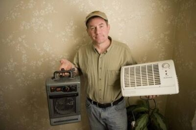 Photo: Joel Sartore displays appliances rescued from the curb on garbage night.