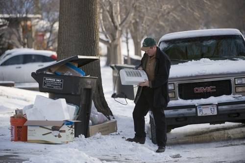 Photo: Joel Sartore patrols the curbs in his neighborhood in hopes of rescuing still useful items before they're hauled to the dump.